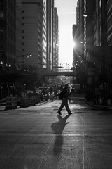 stride (Kenny C Photography) Tags: people sun chicago sunshine sunrise person morninglight illinois shadows streetphotography sunburst downtownchicago windycity kennycphotography