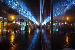 Citycenter at night (JoséDay) Tags: winter nightshot thenetherlands denhaag thehague flickrfriends rainydays singintheblues noflashnightshots flickraward flickrsun panasonicdmctz10 flickrclickx somethingblueiloveit photoaday333 pad333nov29