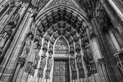 Portal (gambajo) Tags: door old blackandwhite sculpture building church stone architecture blackwhite gate cathedral cologne portal