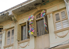 Old colonial house windows in the unesco world heritage zone, Penang island, George town, Malaysia (Eric Lafforgue) Tags: street old city houses windows house history yellow horizontal architecture facade asian outdoors fan asia southeastasia day colonial chinese decoration entrance culture nobody nopeople georgetown architectural historic unescoworldheritagesite malaysia destination historical penang tradition ornate past cultures heritagebuilding cultural rowhouse penangisland traveldestinations pulaupinang buildingexterior placeofinterest lowangleview penangstate colourimage traditionalbuilding builtstructure residentialstructure malay3452