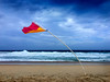 Southerly Buster (caralan393) Tags: flag wind beach red yellow bend sky clouds weather storm wild waves moruya phone