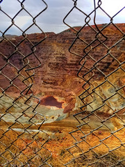 the old mine in Bisbee, AZ (Baja Juan) Tags: hff happy fence friday bisbee arizona chainlink fencing copper mine red orange yellow earth shades cloudy skies adventure travel hdr baja