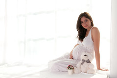 Sitting portrait of pregnant woman (GrasePhoto.) Tags: woman one girl young people lookingatcamera sit white caucasian pretty lovely beautiful pregnant sevenmonth longhair brunette studio slim side profile portrait grey dress smile teeth sarafan belly happy cheer nothing female lady mother attractive natural beauty person bear window curtains fullbody highkey