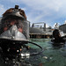 US Sailor prepares to make a MK-20 diving mask familiarization dive with Panamanian divers