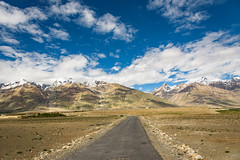 Road on Zanskar Valley around Padum villange and great himalayan range- Ladakh, Jammu and Kashmir, India. (Nuiiko) Tags: road city blue vacation sky cloud india mountain holiday snow texture tourism beautiful field car rural truck trekking river landscape countryside high scenery asia village flat top side hill religion great ground landmark scene tibet sierra ridge mount valley shade area zanskar tibetan unusual kashmir agriculture himalaya agricultural himalayan ladakh jammu upland himal contryside padum zangskar