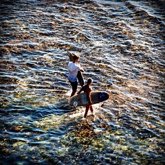 surfers in bali (elisa641) Tags: travel sea bali beach indonesia island travels asia surf sparkle surfers viaggi viaggio theunforgettablepictures uluwatubeach lpsparkle