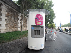 Ouvrez un cru de qualite (RubyGoes) Tags: road bridge pink blue trees red summer sky people white paris france green wall seine grey cafe chairs tables pont banners tap bunting plages