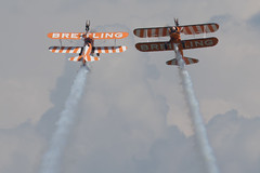 Breitling Boeing N2S-3 Kaydet (B75N1) SE-BOG / 4 (cn 75-7128) and Breitling (AeroSuperBatics) Boeing PT-13D Kaydet (E75) N5057V / 1 (cn 75-5598) crossing (GAN89) Tags: italia codroipo lipi spearman udine rivolto breitlingwingwalkers 55anniversariofreccetricolori