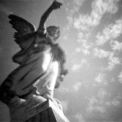 departure (a perhaps hand) Tags: cemetery northerncalifornia angel clouds toycamera vintagecamera marincounty tmax400 statuary plasticcamera blackandwhitefilm caffenol diana151 sanrafaelca mttamalpaiscemetery homedevleloped