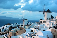 Windmills in indigo (Nagarjun) Tags: blue sunset sun white church island volcano evening europe glow santorini caldera oia cyclades mediterranian firostefani aegeansea