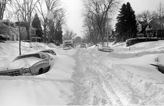 A car drives down a snow packed Elm Street in the South Park Hill neighborhood of Denver, Colorado after the 1982 snowstorm. (Denver Public Library Digital Collection)