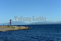60072236 (wolfgangkaehler) Tags: 2016 southamerica southamerican latinamerica chile chilean southernchile town puertovaraschile view lakellanquihue lakedistrict osornovolcano lake mountain volcano waterfront art publicart sculpture sculptures metalart metalartwork metalsculpture metalsculptures woman