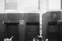 train on the wall (KevinIrvineChi) Tags: city railroad autumn light shadow urban bw sun white chicago black brick wall train outside outdoors blackwhite shadows cta gbrearview outsider bricks rail sunny trains l coupling equinox gapersblock ravenswood chicagoist autumnequinox cityofchicago ctabrownline rapidrail