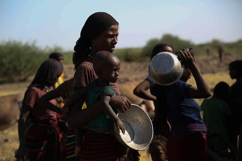 A mother with her child is waiting her turn to get drinking water at Keroma Kebele where a water truck is distributing to the people in Gewane woreda (district), Afar region, Ethiopia.