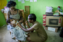 Ghana- June 2014 (mcspglobal) Tags: ghana woman baby healthworker breastfeeding childhealth