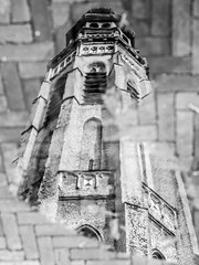 Trapped in a puddle (Wouter de Bruijn) Tags: blackandwhite reflection tower water monochrome rain puddle churchtower clocktower fujifilm middelburg langejan xt1 fujinonxf35mmf14r