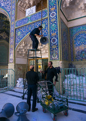 men putting loudspeakers in fatima al-masumeh shrine for ashura celebration, Central County, Qom, Iran (Eric Lafforgue) Tags: old decorations people building vertical architecture religious outdoors site iran muslim islam religion middleeast belief mosque holy ornament ornaments shia muharram iranian ornate sono hussein sights attraction islamic decorated adornment iman loudspeakers shiite hussain 3people qom menonly threepeople ghom persiangulfstates   husayn colourimage qum  iro ornately  masumeh centralcounty westernasia  qomprovince 16492