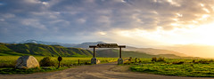 Wind Wolves Preserve Panorama (aaronncollier96) Tags: wind wolves preserve grass green rain drought clouds sky sunset bright colors sign entrance gate road country california winter