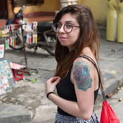 Glasses and Tattoo (Ron Scubadiver's Wild Life) Tags: girl woman people candid street style nikon 24120 outdoor vietnam hoian tattoos