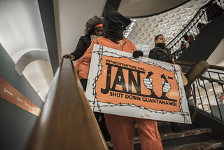 An Anti-Torture Protester Holds a Sign Marking the January 11th Anniversary of Guantánamo's Opening While Descending Stairs at Union Station