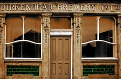 Ornamentation (innpictime ζ♠♠ρﭐḉ†ﭐᶬ₹ Ȝ͏۞°ʖ) Tags: 533950723013060 birkenhead pierhotel birkenheadbrewery pub bar hotel closed closedbrewery tiles signage windows ornamentation canningstreet hughwilliams woodside wirral merseyside panel sepia selectivecolour reflection door doorway entrance green frontage shut building architecture