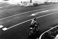A cold ride (Nikon FE2) (stefankamert) Tags: meinfilmlab wwwmeinfilmlabde stefankamert street road cold winter woman cycle bicycle bw sw baw noir noiretblanc blackandwhite blackwhite monochrome nikon fe2 nikonfe2 film analog kodak trix nikkor