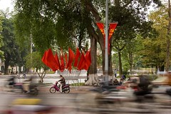 Flagged in traffic (Kalabird) Tags: travel vacation asia vietnam hanoi mirrorsofsociety hoankiemlake itsongselection itsongcanoneos20d itsongmirrorssoutheastasia readingthepaper canonef24105mmf4lisusm