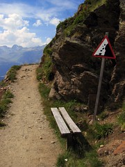 beware of falling rocks when sitting (ianlord) Tags: 2005 summer mountain alps sign bench switzerland funny europe swiss trail avalanche