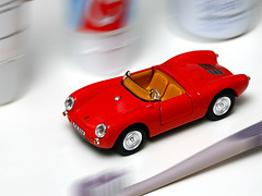 Bathroom racer (Rune T) Tags: red white macro speed bathroom movement action experiment racing shelf toothpaste colgate toothbrush toycar deodorant spinningwheels moisturizingcream porsche550spyder