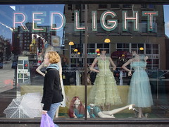 Red light in the U District (AnnabelB) Tags: 2005 seattle light red usa reflection window shop shopping washington dress u redlight westcoast ort udistrict