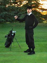 sometimes i golf.. (striatic) Tags: portrait selfportrait canada me grass hat club golf photo edmonton outdoor dusk 2006 alberta striatic golfbag anhat flickr:user=striatic