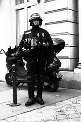 Police & Grenades (Pierre-Elie de Pibrac) Tags: life blackandwhite paris art noiretblanc culture police society amateur franais manif vie artiste cpe photographe jeune anticpe emeutes photographeamateur
