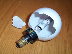 burst fluorescent Christmas bulb (TheDamnMushroom) Tags: christmas entropy fluorescent sylvania c7
