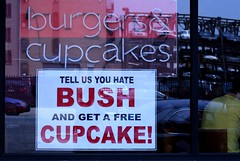 free cupcake (view-askew) Tags: nyc newyorkcity usa newyork reflection window bush cowboy war funny georgewbush president georgebush iraq free anger cc cupcake hate algore napoleon blogged gothamist antibush saddam moveon climatechange hussein saddamhussein nobelprize neocon tagwhoring