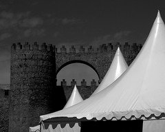Contrasting Structures (Monster.) Tags: old white holiday stone modern dark tents spain citywalls temporary flimsy avila permanent solid canvass spainholiday holiday2006 spanishholiday spainholidayset