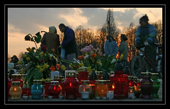 People laying candles and flowers