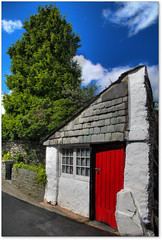 Red ~ Green ~ Blue (Robert Silverwood) Tags: door blue red sky white house color colour building tree green stone village lakedistrict cumbria slate outbuilding annexe hawkshead