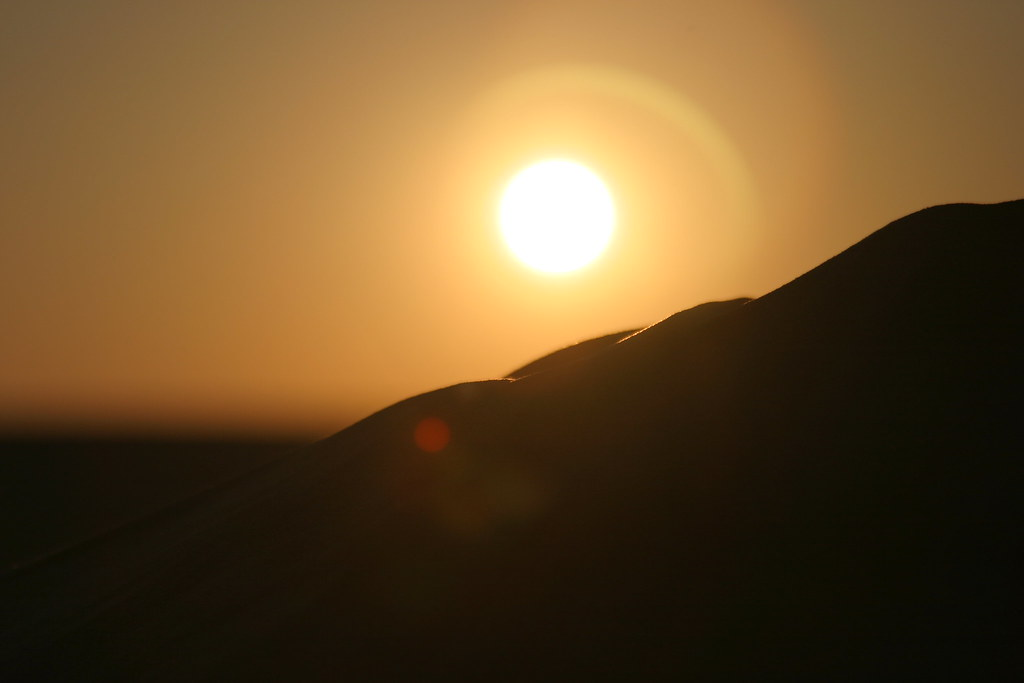 Sunset behind dunes in the Black and White Desert, Egypt