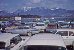Scenic car park at the foot of Burrard Street March 1964 (D70) Tags: park street mountain ski mountains ford chevrolet car station vancouver sedan austin wagon foot for mercedes coast march buick view harbour britishcolumbia scenic grouse plymouth slide mount stanley frame half scanned dodge inlet burrardinlet valiant burrard kodachrome seymour texaco standard esso fuel fairlane 1964 vessels coalharbor chevyii slopes