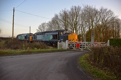 37605 & 37603 crossing over the road at the Clay Hills Crossing, just outside of Leiston, with the return working to Willesden. 11 01 2017 (pnb511) Tags: eastsuffolkline saxmundham suffolk train class37 diesel locomotive loco railway branch branchline aldeburgh levelcrossing rural trees road track
