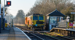 Colas Track Machine passing the soon to be demolished signal box at Fiskerton on 20-01-2017 (kevaruka) Tags: fiskerton fiskertoncrossingbox signalbox historic history trains train transport trainstation england nottinghamshire winter 2017 january sun sunshine sunny sunnyday colour colours flickr thephotographyblog ilobsterit frontpage kevinfrost telephoto telephototrains uwa ultrawideangle canon canoneos5dmk3 canon5dmk3 canon70200f28ismk2 canonef1635f28mk2 5d3 5diii 5d 5dmk3 60100 red dbschenker dbc 6e54 blue green locomotive composition track railfreight railway