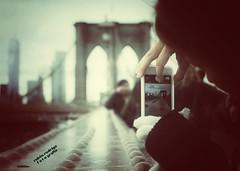 Tourist (Mister Blur) Tags: brooklyn bridge new york city bokeh iphone mygirl nikon d7100 35mm shallow depthoffield focus