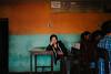 Kathmandu, Nepal 2016 (f.d. walker) Tags: asia kathmandu nepal streetphotography street sunlight shadow streetportrait lonely alone sitting candidphotography candid color clothes colorphotography contrast colors city table travel travelphotography woman women face room