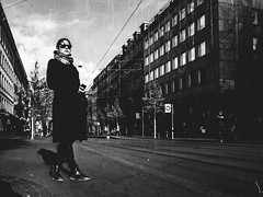 waiting on the world to change (matthias hämmerly) Tags: switzerland world street photography shoot black white bw candid going collecting story faces journalism real honest moments decisive moment creative ricoh gr2 gr girl bahnhofstrasse woman