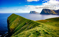 A man in Kalsoy - Faroe Islands (@PAkDocK / www.pakdock.com) Tags: 2016 faroe landscape pakdock travel lake sea nature island clouds ocean outdoor grass man green village sunny islands cliff panoramic outdoors landmark trek grassland adventure planet voigtlander wanderlust faroese kalsoy 15mm trekking trekker giants sony sonya6000 a6000 islas feroe acantilado aventura naturaleza