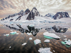 Near The Antarctic Circle (glness) Tags: antarctica antarcticpeninsula antarcticcircle mountains icebergs driftice packice nationalgeographic boat ship nationalgeographicexplorer expedition lindbladexpeditions austral summer natgeo natgeotravel lexshare southernocean wildlife ©gregness hank you