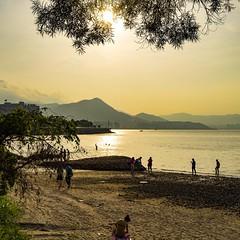 sunbath (Kai-Ming :-))) Tags: sunset mountain tree green beach water yellow backlight 35mm landscape hongkong sony sunbath waterscape swimmingsuit maonshan kaiming ilce7m2