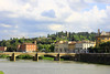 Bridge across the River Arno (U A Satish) Tags: bridge sky italy clouds river florence outdoor hill tuscany riverarno colourfulbuildings uasatish httpuasatishcom