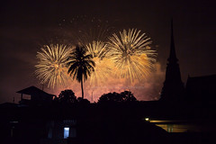 Fireworks over Chanthaburi old town (baddoguy) Tags: tree silhouette horizontal night thailand outdoors photography pagoda southeastasia cityscape nopeople celebration copyspace oldtown unusualangle 2015 thaiculture colorimage fireworkdisplay locallandmark goldcolored coconutpalmtree