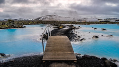 The blue lagoon - Iceland - Travel photography (Giuseppe Milo (www.pixael.com)) Tags: travel bridge blue sky mountain black nature water clouds landscape geotagged photography lava is photo iceland sand rocks europe outdoor sony lagoon steam fullframe onsale a7 geological southernpeninsula sonya7